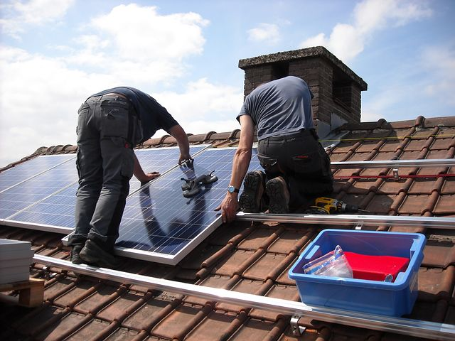 two men installing solar panels